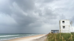 Storm front moving in on beach with cloudy sky Stock Footage