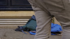 Homeless begging in the street: young jobless man  Stock Footage
