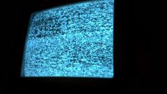 Creepy TV static on small screen Stock Footage