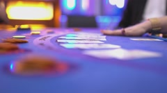 Gambling Black Jack in a casino - dealer adds cards on Black Jack Stock Footage