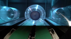 Stock Video Footage of Plastic bottle going into recycling crusher