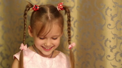 Little girl with pigtails smiles sweetly. Stock Footage