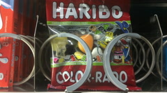 Haribo Color Rado gummi candy coming from vending machine Stock Footage
