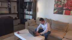 Young white businessman home, high life, freelancer working, indoor business man - stock footage