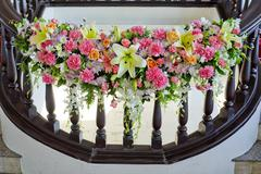floral decorate in handrail of stairs at the wedding - stock photo