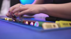 Gambling Black Jack in a casino - dealer sorts gaming chips and starts game - stock footage