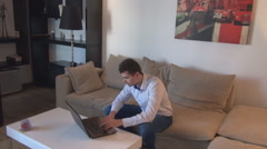 Focused white business man indoor, apartment view, work from home, inside action Stock Footage