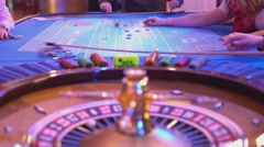 Roulette table in a casino - roulette wheel - stock footage