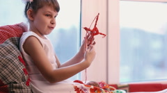 Little girl in white shows his crafts. Stock Footage