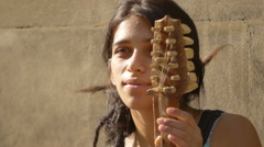 Portrait of a young east european woman playing a string in the street Stock Footage