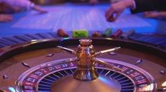 Roulette table in a casino - people playing roulette - stock footage