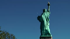 Stock Video Footage of USA New York City 416 statue of liberty with blue sky and moon in background