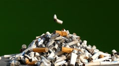 Cigarette butts - slow rotation, slow motion Stock Footage