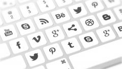 Closeup on keyboard buttons being pressed with social media icons on keys Stock Footage