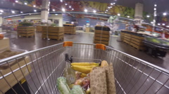 Shopping cart moving through supermarket - stock footage