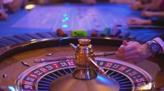 Roulette table in a casino - full roulette game - ball lands on field 2 black Stock Footage