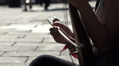 playing a string instrument: bow, melody, street music, street artist - stock footage