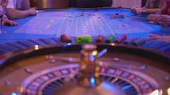 Roulette table in a casino - groupier collects lost chips from roulette table Stock Footage