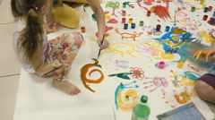 Small children painted on the floor of the big picture. - stock footage