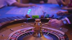 Roulette table in a casino - spinning wheel - ball lands on field 9 red - stock footage