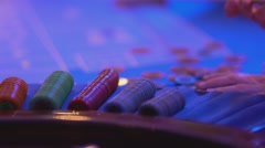 Roulette table in a casino - groupier collects chips - stock footage