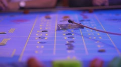 Roulette table in a casino - groupier removes lost tokens from table Stock Footage