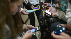 Children with their Smartphones and mobile phone in school Stock Footage
