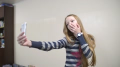 Girl Makes Selfie in the School Via Smart Phone Camera Stock Footage