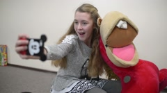 Girl Makes Selfie in the School Via Smart Phone Camera at school class room Stock Footage