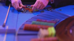 Roulette table in a casino - sorting gaming chips - stock footage