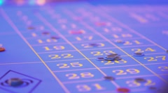 Roulette table in a casino - removing lost bets from table - stock footage