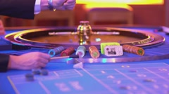 Roulette table in a casino - amazing view on roulette wheel - stock footage