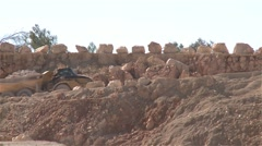Loaded dump truck passing on a road in a quarry Stock Footage
