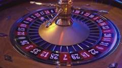 Turning Roulette Wheel in a casino Stock Footage