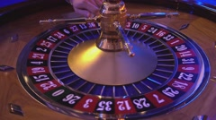 Roulette Wheel in a casino - ball on field 25 red Stock Footage