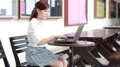 Thai adult businesswoman beautiful girl using computer notebook. Stock Footage