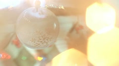 Sparkling garland and christmas tree toy. Christmas tree blurry lights. Stock Footage