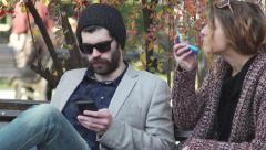 Park 4k People on the street are resting communicate write sms sit in social Stock Footage