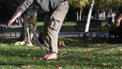 Park The guy is learning to keep the balance of a tightrope walker.mp4 Stock Footage