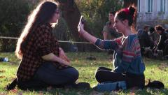Stock Video Footage of Park 4k People relax in the fresh air, share news on social networks, laughin