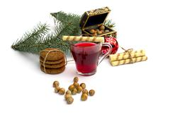 Stock Photo of cup of tea, casket, fir-tree branch, cookies and nutlets