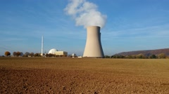 Nuclear power plant on the sky background in sunlight - stock footage