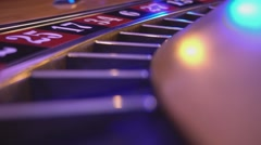 Close Up of a roulette wheel in a casino - camera fixed on wheel - stock footage