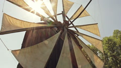 Old windmill with cloth sails - Dolly shot - stock footage