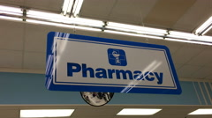 Close up pharmacy sign inside London drugs store. Stock Footage