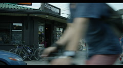 Corner store on busy street Stock Footage