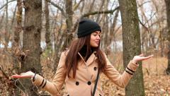 Beautiful young woman outdoor presenting on hands copy space Stock Footage