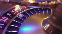 Roulette Wheel in a casino - ball in field 23 red - stock footage
