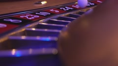 Macro view on a Roulette Wheel in a casino - ball falls in field 24 black - stock footage