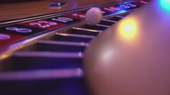 Macro view on a Roulette Wheel in a casino - ball falls in field 10 black Stock Footage
